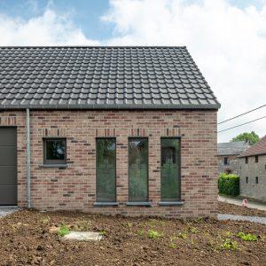Façade arrière d'une maison contemporaine à Heron - Cabinet Kinésithérapie