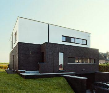 Façade avant d'une maison contemporaine à Crisnée
